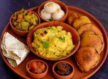 Traditional Bengali thali meal served in terracota dish royalty free stock images