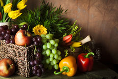 Traditional basket of harvested fruit and vegetables Royalty Free Stock Photo