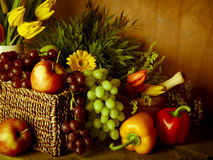 Traditional basket of harvested fruit and vegetables Royalty Free Stock Image