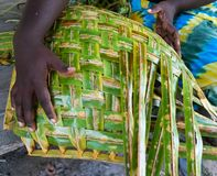 Traditional basket weaving with coconut palm leaves, Solomon Islands stock photos