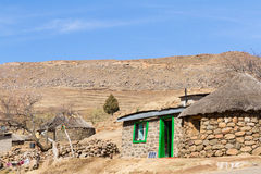 Traditional Basotho Hut with Green Door. Traditional Basotho huts on a sunny winter day in rural Leribe, Lesotho Royalty Free Stock Image