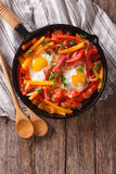 Traditional Basque piperade with eggs close-up. vertical top vie royalty free stock images