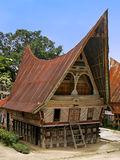 Traditional Batak house on Samosir island, Sumatra, Indonesia Royalty Free Stock Photo