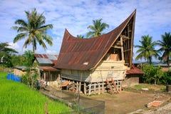 Traditional Batak house on Samosir island, Sumatra, Indonesia Royalty Free Stock Photo