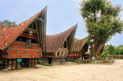 Traditional Batak houses on Samosir island, Sumatra, Indonesia Royalty Free Stock Images