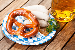 Traditional bavarian food. (sausages, pretzel and a beer stock image