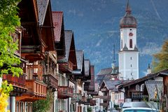 Traditional Bavarian houses and church in Garmisch Germany stock photography