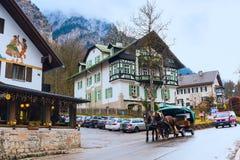 Traditional bavarian houses near Neuschwanstein in german alps in Bavaria Royalty Free Stock Photo