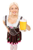 Traditional Bavarian woman holding a pint of beer Stock Photos