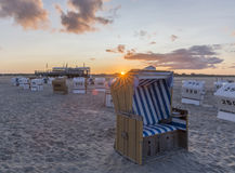Traditional beach baskets or hooded beach chairs at nothern Germany. Traditional beach baskets or hooded beach chairs at Schleswig-Holstein, nothern Germany Stock Image