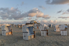 Traditional beach baskets or hooded beach chairs at nothern Germany. Traditional beach baskets or hooded beach chairs at Schleswig-Holstein, nothern Germany Stock Images
