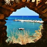 Traditional beautiful Greek village of Panormos on the island of Crete. Summer background for travel and holidays. Traditional beautiful Greek village of Stock Photography
