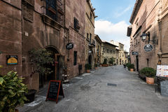 Traditional beautiful street of medieval Spanish village at Barcelona town, Catalonia, Spain Royalty Free Stock Images