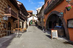 Traditional beautiful street of medieval Spanish village at Barcelona town, Catalonia, Spain Royalty Free Stock Photo