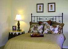Traditional bedroom with side lamp. Traditional bedroom with floral bedding and side table Royalty Free Stock Images