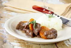 Traditional beef goulash, topped with potato Stock Images