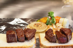 Traditional beef teppanyaki on a hot plate Royalty Free Stock Image