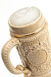Traditional beer mug with froth over white Royalty Free Stock Images