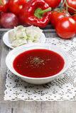Traditional beetroot soup on old wooden table. European dish stock images