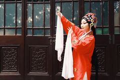 Chinese opera woman.Practicing Peking Opera in the garden, Colorful, china Royalty Free Stock Photos