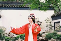 Chinese opera woman.Practicing Peking Opera in the garden, Colorful, china Stock Photos
