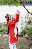 Chinese opera woman.Practicing Peking Opera in the garden, Colorful, china Stock Photography