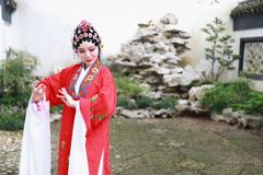 Chinese opera woman.Practicing Peking Opera in the garden, Colorful, china Royalty Free Stock Photo