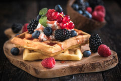 Traditional Belgian waffles with berry fruit and ice cream Stock Photo