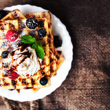 Traditional Belgian waffles with ice cream and berry fruits on Royalty Free Stock Photo