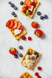 Traditional belgian waffles with whipped cream and fresh fruits Stock Photo