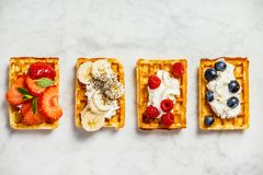 Traditional belgian waffles with whipped cream and fresh fruits Royalty Free Stock Photo