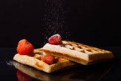 Traditional belgium soft waffles with strawberries and powdered Stock Photos