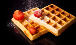 Traditional belgium soft waffles with strawberries and powdered Royalty Free Stock Photo