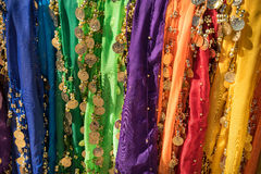 Traditional belly dancer skirt colorful vibrant background Stock Photo