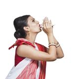 Traditional Bengali woman blowing shankha Stock Images