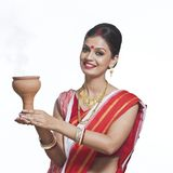 Traditional Bengali woman holding oil lamp Stock Image