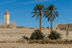 Kasbah, Traditional berber clay settlement in Sahara desert, Morocco. Traditional berber clay settlement in Sahara desert, Morocco Stock Photos