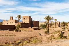 Kasbah, Traditional berber clay settlement in Sahara desert, Morocco. Traditional berber clay settlement in Sahara desert, Morocco Royalty Free Stock Photo
