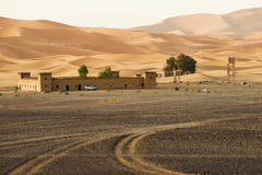 Traditional berber house in sand dunes Stock Image