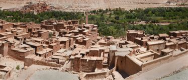 A traditional Berber village, a clump of clay houses with a flat roof, on the outskirts of a settlement a strip of trees, Morocco,. Traditional Berber village, a Stock Photography