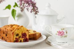 Traditional berry fruits pound cake for breakfast. On a table with a cup of tea royalty free stock photography
