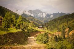 Traditional Bhutanese architectures with Himalayas view on the way to Punakha to Trongsa. Sunlight hits the road Stock Photography