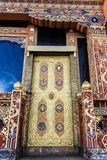 Traditional Bhutanese ornate temple door in Bhutan, South Asia. stock photography