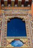 Traditional Bhutanese ornate temple window in Bhutan, South Asia. stock image