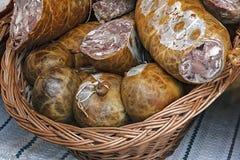 Traditional bio aspic pieces in wicker basket Stock Photos