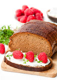 Traditional black rye bread with raspberries and thyme and soft Stock Image