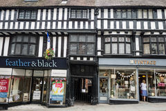 Traditional black and white building Shrewsbury, Shropshire, Eng. Shrewsbury, UK - July 7, 2014: traditional black and white buildings with shops in the main Royalty Free Stock Images