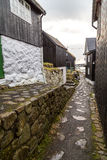 Traditional black wood and stone houses leading down to the harb Royalty Free Stock Photography