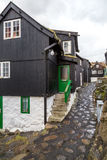 Traditional black wood and stone houses near the harbour in Tors Royalty Free Stock Photo