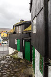 Traditional black wood and stone houses next to the harbour in T Stock Photos
